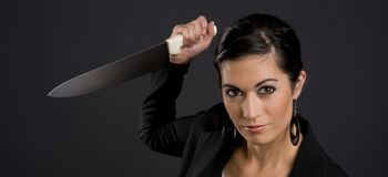 Pretty Stabber Woman Attacks Large Kitchen Knife. Pretty Woman getting ready to stab you Royalty Free Stock Photos