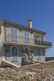 Pretty stone house with blue shutters and a balcon Royalty Free Stock Images