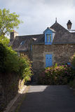 Pretty stone house with blue windows. In Rochefort en Terre Stock Photos