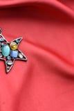 Pretty stones star pendant Stock Photos