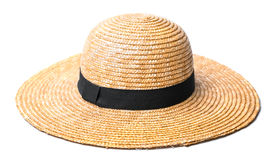 Pretty straw hat with a black strip on white background beach hat top view  Royalty Free Stock Photos