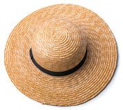 Pretty straw hat with ribbon and bow on white background beach hat top view isolated Royalty Free Stock Images