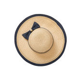 Pretty straw hat with ribbon and bow on white background. Beach hat top view isolated Royalty Free Stock Photos