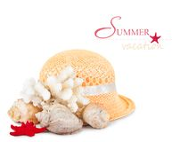 Pretty straw hat with starfish, pebble and  mussel Stock Images