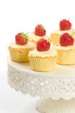 Pretty Strawberry Cupcakes. Strawberry topped cupcakes on pretty cake stand Royalty Free Stock Image
