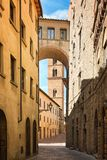 Pretty street in the ancient city of Tuscany Stock Image