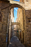 Pretty street in the ancient city of Tuscany Stock Photos