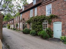 Pretty street of brick houses in village of Hambleden. Street of brick homes and houses in the Chilterns village of Hambleden in Buckinghamshire royalty free stock images