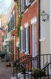Pretty street scene with flags hanging outside homes that line cobblestone streets,Old Town,Alexandria,Va,March,2015 Stock Image