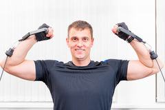 Pretty strong man is engaged in sports hall. Pretty strong man is engaged in a sports hall Royalty Free Stock Image