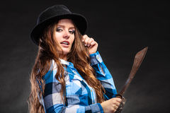 Pretty strong woman in hat holding machete. Stock Image