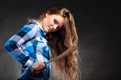 Pretty strong woman holding machete. Royalty Free Stock Image