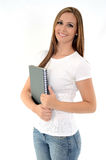 Pretty student. Beautifull smiling young woman with a notebook on white background Stock Image