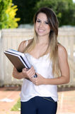 Pretty student. Beautiful young woman with notebooks in a garden Stock Photos