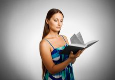 Pretty student with book Royalty Free Stock Photography