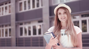 Pretty Student with Books Against the University Stock Image