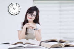 Pretty student with books on desk Stock Images