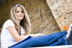 Pretty student with books and flower Royalty Free Stock Photography