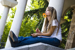 Pretty student with books and flower Stock Photography