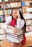 Pretty student with books showing ok sign Royalty Free Stock Images