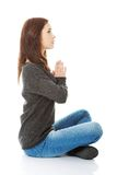 Pretty student girl meditating in lotus pose. Stock Photography
