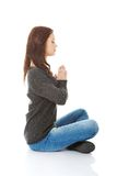 Pretty student girl meditating in lotus pose. Stock Images