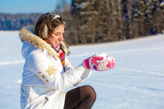 Pretty student girl with snow in palms Stock Image
