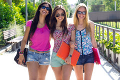 Pretty student girl with some friends after school Stock Photos