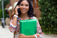 Pretty student girl talking on the phone. Stock Photography