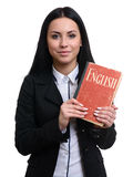 Pretty student holds an english textbook Royalty Free Stock Image