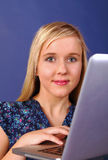 Pretty student on laptop Royalty Free Stock Image