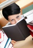 Pretty student looks out over the book Royalty Free Stock Photo