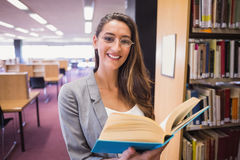 Pretty student reading book in library Royalty Free Stock Photo