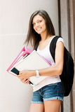 Pretty student ready for class. A pretty young college or high school age girl with study materials stock photography