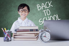Pretty student with science books in class Royalty Free Stock Images