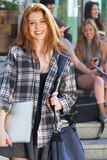 Pretty student smiling at camera outside. On campus at the university Royalty Free Stock Image