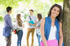 Pretty student smiling at camera outside Stock Photos