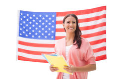 Pretty student smiling holding notebooks Stock Photography