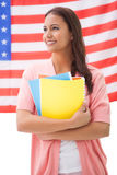 Pretty student smiling holding notebooks Stock Images