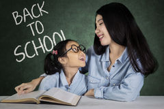 Pretty student speaking with teacher Royalty Free Stock Photography