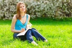 Pretty student studying outdoors Stock Image