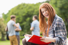 Pretty student studying outside on campus Royalty Free Stock Images
