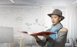 Pretty student studying science . Mixed media Stock Photo