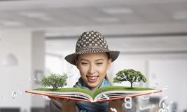 Pretty student studying science . Mixed media Royalty Free Stock Photography