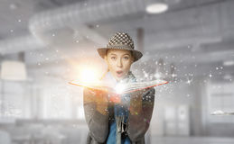 Pretty student studying science . Mixed media Royalty Free Stock Images