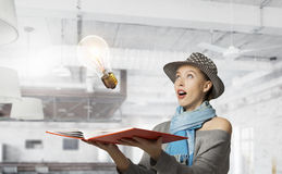 Pretty student studying science . Mixed media Stock Photography