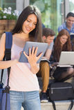 Pretty student using her tablet pc on campus Royalty Free Stock Image