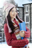 Pretty student wearing sweater and wink Royalty Free Stock Photos