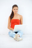 Pretty student working on her laptop Royalty Free Stock Image