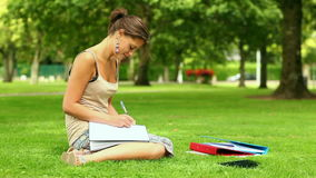 Pretty student writing outside stock footage